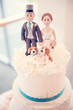 Bride and groom cake topper with beagle dogs at Harbour heights wedding. Photography by one thousand words wedding photographers