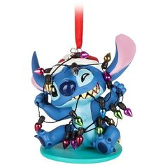 Amazon.com: Disney Stitch Santa Ornament: Home & Kitchen (890 MXN) ❤ liked on Polyvore featuring home, home decor, holiday decorations, disney holiday decor, santa claus ornaments, disney holiday decorations, disney ornaments and father christmas ornament