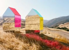 American photographer, Autumn de Wilde has designed a pair of transparent and reflective jewel toned structures for a photo-shoot in the dry Californian landscape.  Made of a combination of mirror and coloured plexiglass, images of the landscape are reflected on the structure, and  the landscape is simultaneously cast with rose, warm gold and aqua tinted sunlight. The reciprocal exchange of colour, light and refraction are truly exquisite.