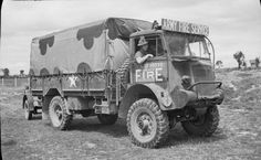 A Bedford QL 3 ton truck, one of the tenders of 104 Fire Fighting Company (Army Fire Service), stationed in Caen.                   .