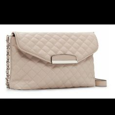 CREAM LEATHER QUILTED CROSSBODY Lining material is nylon. Clasp closure. Gold chain strap. Can be used as a shoulder bag, crossbody or clutch. Bi-cast or PU leather Bags Crossbody Bags