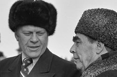 President Ford wearing a Russian wool cap is greeted by Soviet General Secretary Leonid Brezhnev in Vladivostok Russia. November 23 1974