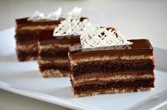 The best chocolate cake gets layered with hazelnut dacquoise and a nutella frosting in between each layer.