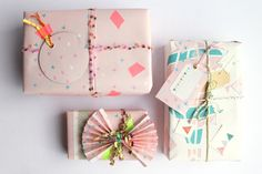 Creative Wrapping with cute papers. Like the little stamps.