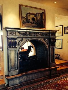 By Carmen Illustrates Antiquing of white canterra stone fireplace.