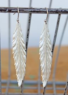 """Matte silver leaf danglers evoke Autumn and all things naturally beautiful. Measures 3"""" long including hook.  $26.00"""