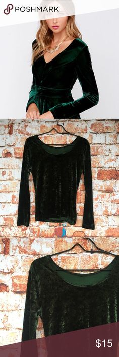 Dark green velvet shirt Trendy and elegant crushed velvet long-sleeve shirt in a dark forest green. Features a boat neck and slim silhouette. First pick for style inspo only! Moda International Tops Tees - Long Sleeve