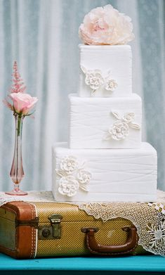 Love the use of vintage suitcase as cake stand!