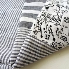 Black and White Stripe and Warli Print Handloom Handwoven Cotton Fabric ₹150.00 Black and white stripe with warli print Handloom cotton. Unique print perfect for any sewing craft such as dresses, bag, pouch, quilt, home decor, etc.http://shop.chezvies.com/#!/Black-and-White-Stripe-and-Warli-Print-Handloom-Handwoven-Cotton-Fabric/p/83205097