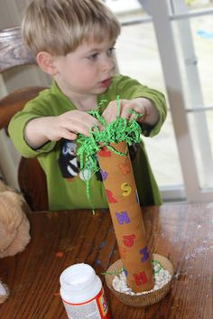 """""""Chicka Chicka Boom Boom"""" - letter matching on paper towel roll - and some greens to make a tree. GREAT WAY TO LEARN LETTERS BY MATCHING"""