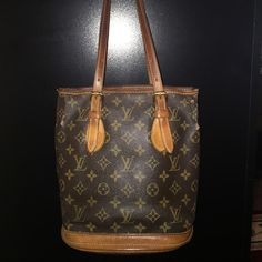 Louis Vuitton Bucket PM Shoulder Tote Bag Authentic Louis Vuitton Bucket PM Shoulder Tote Bag. I bought this off another posher who guaranteed authenticity. Unfortunately for me it's not the same bag they listed. It's a beautiful bag but it's more damaged then the one they actually listed. But my loss is your gain! There's some cracking in the leather/A ink stain I believe on the bottom & the inside is peeling but not sticky. The date code is very hard to make out but with a bright enough…