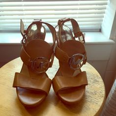 Michael Kors tan wedge heels Only wore once...small on me great condition! Michael Kors Shoes Wedges