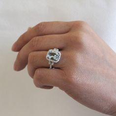 Cushion aquamarine engagement ring diamond halo three stone band