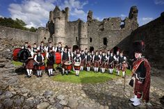 Balvenie Castle at Dufftown with the full Pipe Band.  Their music is enjoyed all summer at the Highland games