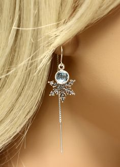 These frozen snowflake earrings are lightweight, comfortable, feminine, and perfect for a winter wedding, or for the Elsa / Disney Frozen fan or Game of Thrones fan in your life (winter is coming). Made from sterling silver, these delicate threaded earrings are accented with a sterling silver plated Swarovski crystal, in ice blue Aquamarine. These lightweight earrings are extremely comfortable to wear, and make excellent bridesmaid gifts for your winter wedding. Total length is 2.25 inch...