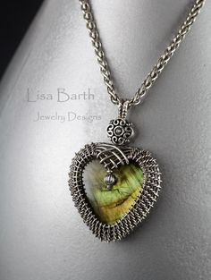 Heart shaped Pendant from a variation of technique presented in my new book, Wire Weaving; The Complete Course. The stone is Labradorite and it was woven with sterling silver wire. --Lisa Barth