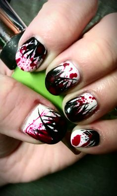 | Black red and white splatter/spray nail art. | What I would do is trade the red splats for multicolor ones!