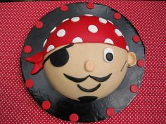 Pirate cake...for twins bday.  One cake with a brown eye & one with a green eye :)