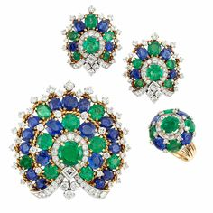 Gold, Platinum, Emerald, Sapphire and Diamond Clip, Pair of Earclips and Ring The clip centering one round emerald approximately 3.75 cts., the whole embellished by 54 round and oval emeralds and sapphires approximately 39.00 cts., highlighted by 3 square-cut and 175 round diamonds approximately 9.35 cts., the clip and earclips accented by rope-twist gold, the ring completed by five row wire shank, circa 1960, approximately 56.6 dwts. Size 6 1/2.
