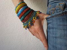 Alcea Rugosa  ... Freeform Crochet Cuff - Flowers -  Yellow Orange Emerald Blue Green - Beaded Beadwork. $168,00, via Etsy.