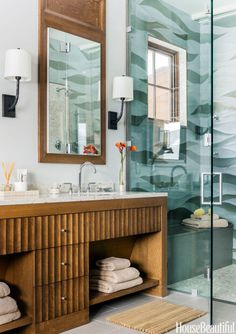 """For inspiration, designer Jennifer Palumbo looked to the nearby mountains, forests, and streams in this Stowe, Vermont, bathroom. """"The snowy mountains are right outside, but inside it's warm, calm, and luxurious,"""" she says."""