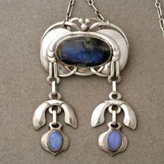 Pendant/Brooch | Georg Jensen. Handmade; sterling silver, labradorite and two opals. Design No. 25 | ca. 1909 - 1914