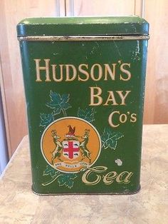 Hudson's Bay Co's Tea vintage rectangular tea tin, HBC coat of arms and maple leaves on forest green, c. 1920s-1930s, Canada