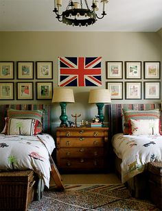 Great child's room - green lamps, tole chandelier, framed book pages, twin beds with wicker trunks - Elle Decor