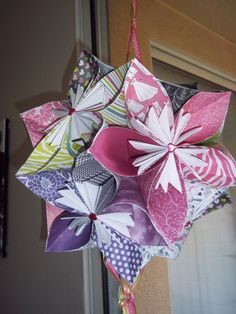 Giant Japanese Kusudama Oragami Flower.  This paper flower is made using 12X12 in. card stock.