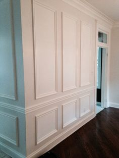 White Kitchen Wall Molding, Angled hard wood floor, 3 inch planks