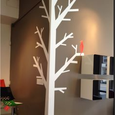 Leading into family wall, love the 'family tree' notion, painting this and pictures come off the branches? Paper tree on one of the pillar corners. Could hang light items off branches