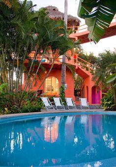 Casa Dos Chicos, Sayulita, Mexico | orange colorful homes outdoor pool