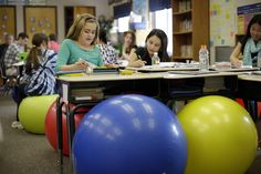 Teachers ditch student desk chairs for yoga balls