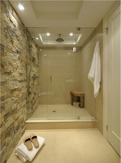 Maybe natural stone surround for tub and in shower stall with blue/green glass tile inset strip?