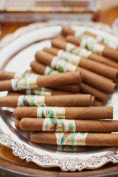 Maybe a cigar bar/roller at the wedding. The men love their cigars!