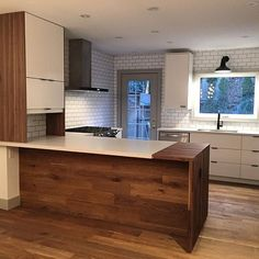 Another sneak peak at the walnut butcher block waterfall on the peninsula for choppin' and prepin'. We wrapped the hardwood up under the island to make it feel cozy. #projectclendenan #interiordesign #sybrandtcreative
