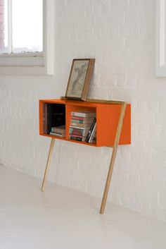 Lean Console is a vibrant, utilitarian, storage solution. Designed for those unused areas of your home, perfect for hallways.  Customise your Lean Man with a block of colour.