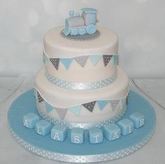 2 tier blue & grey christening cake with train topper