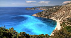 Greek beach off the Mediterranean Coat. Just look at that water!!