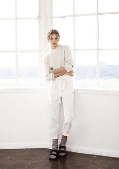 White sweater, white pants, black sandals, grey socks