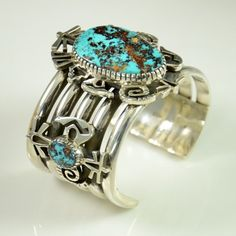 Persian Turquoise Bracelet by Kee Yazzie Jr.   Kee Yazzie translates ancient petroglyphs from the canyons near his Ganado, Arizona home into contemporary jewelry.