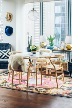 Today I'm sharing our Rove Concepts dining room. I'm obsessed with our wishbone chairs, marble tulip table and bright dining space.