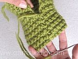 Knitted DROPS slippers with 1 thread Big Fabel og 2 threads Fabel.
