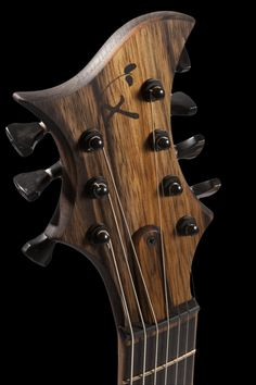 Headstock of the guitar including Hipshot locking tuners, Xylem logo inlay and Black Tusq nut