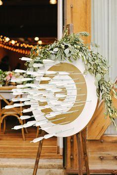 arrow seating chart - photo by Rebekah Westover http://ruffledblog.com/camping-inspired-wedding-at-sundance-resort #weddingideas #seatingchart #arrows