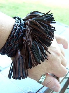 Check out this item in my Etsy shop https://www.etsy.com/listing/215444194/anya-leather-tassel-wrist-wrap