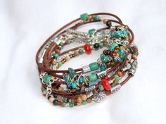 This super sweet bracelet is made with earthy brown leather cording, red coral, turquoise, assorted gemstones and glass, metal beads and a silver chain. Wraps 3 times or can be worn as a necklace!  http://etsy.me/Sm7RGo