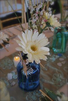 gerbera daisy in jar, vintage bottles centerpiece, bottles and flowers, shabby-chic wedding, www.theloftflorist.com