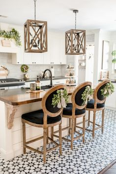 Black & White Farmhouse- love the wood countertop and corbels and those chairs