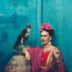 Frida Kahlo with her pet eagle in Coyoacán, Mexico, 1939.